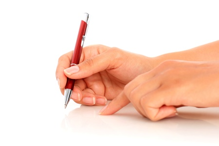 red pen: Pen in hand isolated over white. Stock Photo