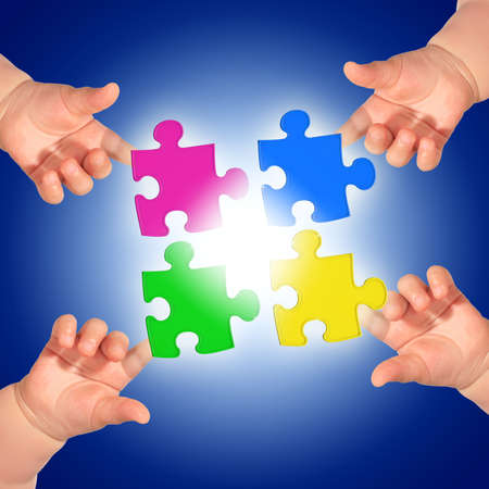 Puzzle and hands over blue background  photo