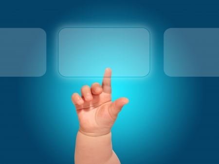 technology metaphor: Baby hand pressing glass button. Stock Photo