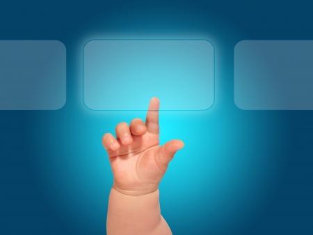 Baby hand pressing glass button. Archivio Fotografico