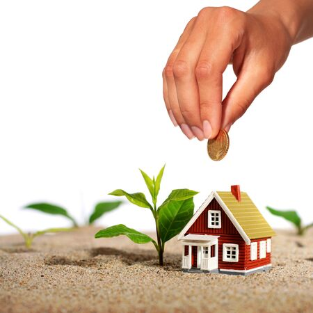 real estate growth: Hand with coin and house