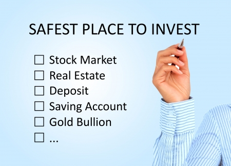 safest: Hand is writing investment plan
