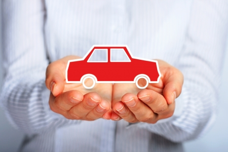 car insurance: Hands and car. Car insurance concept.