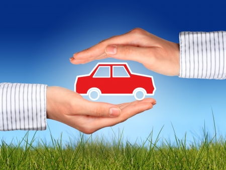 Hands and car. Car insurance concept. photo