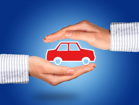 Hands and car. Car insurance concept.