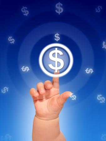 Kids hand pressing make money button. photo