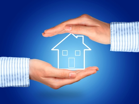 House insurance concept over blue background. photo