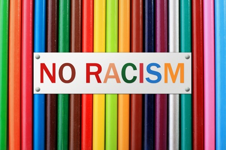 racism: Colorful pencils isolated over white background.