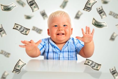 Young businessman. Kid and a lot of money. photo
