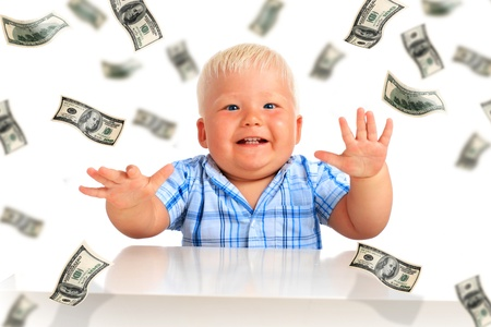 Young businessman. Kid and a lot of money.