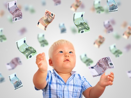 Young businessman. Kid and a lot of money. Stock Photo - 21305293