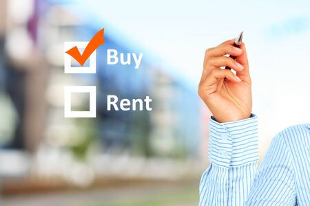 Buy or rent concept. Building on the background