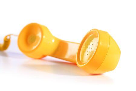 Yellow Telefon isoliert über weißem Standard-Bild - 72299464