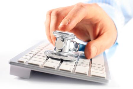 Close-up of stethoscope on keyboard