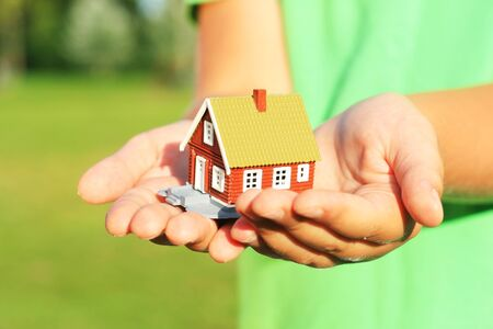 Hand is giving a house Stock Photo
