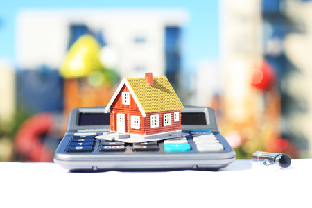 House and calculator. Real estate on the background. Banque d'images