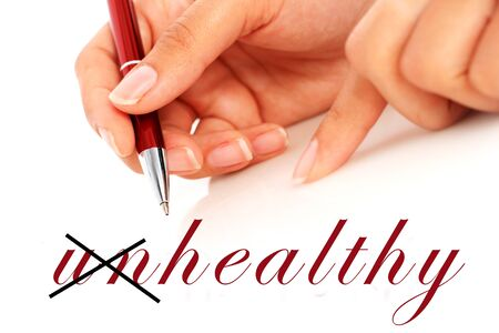 Health concept. Hand is writing word health.