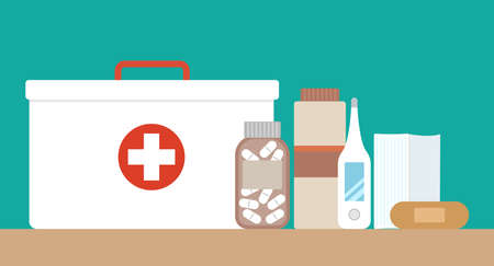 First aid kit with medical equipment and medications. Vector illustration in a flat style.  イラスト・ベクター素材