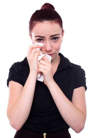 hanky: Red haired young business woman crying and wiping her eyes with a hanky, Isolated on white