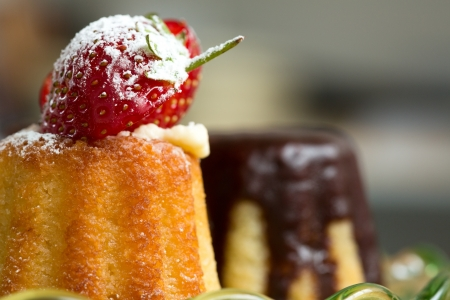 fluted: Fresh whole strawberry on a freshly baked fluted sponge cake for a delicious fruity dessert