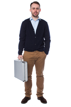 middleman: Casual confident young businessman holding a briefcase standing with his hand in his pocket smiling at the camera, full length on white