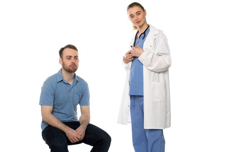 Male Patient Sitting with Standing Female Doctor on white background. photo