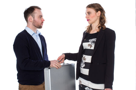 passing over: Woman gives young man briefcase on white background