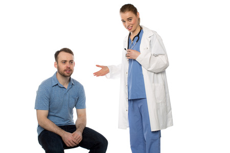 Female doctor presenting male patient on white background photo