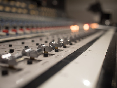 Close up Audio or Sound Mixer Sliders in a Recording Studio.
