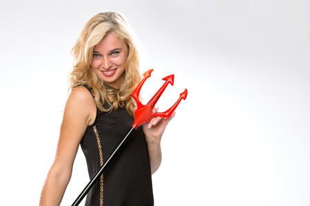 Woman wearing a black dress holding a red pitchfork