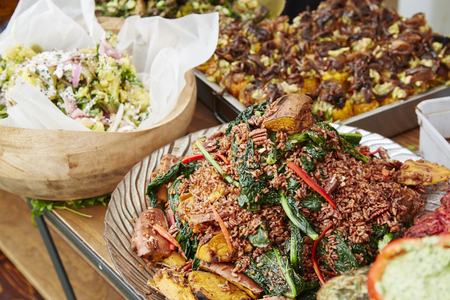 wider: Wider shot of a table of food on display at a farmers market