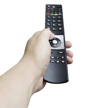 Close up of the hand of a man adjusting the volume on an infrared remote control as he points it away from the camera, isolated on white