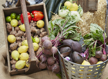 Wide shot of fruit and vegetables in a basket at a farmers market