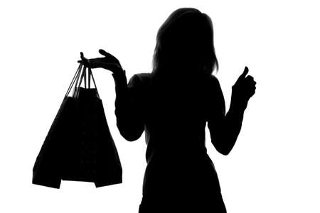 silhouette of a woman with shopping bags