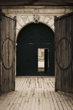 Wooden gate leading to the old doors in the ancient ancient manor house of the Polish prince interesting with its architecture