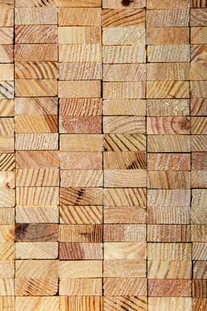vertical wood background from wooden slats, composite texture of orderly folded wooden rectangles