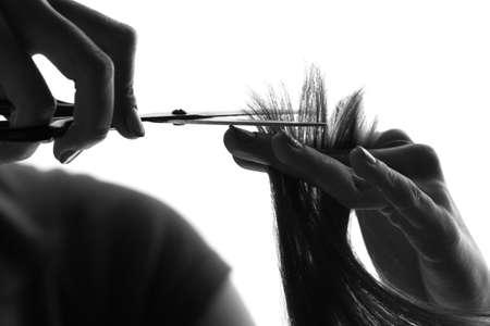 silhouette hairdresser cutting a client Reklamní fotografie