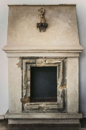 Museum exhibit of the old fireplace stove inside the estate of the Polish prince