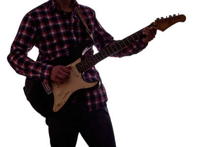 young guy playing on electric guitar on white isolated background