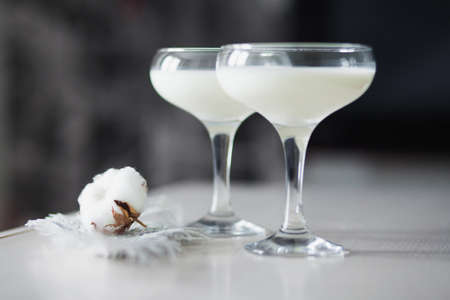 cotton flower: Two glasses filled with milk and put together with a cotton flower and thuja