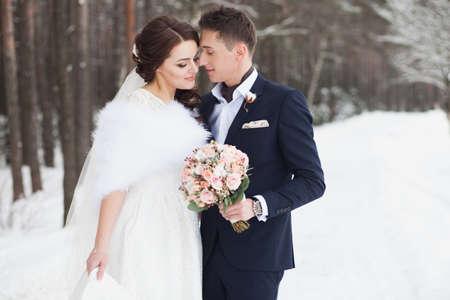 Beautiful wedding couple outdoor in winter Stock Photo