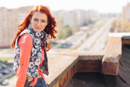 ringlets: Beautiful redhair girl in casual on the rooftop Stock Photo