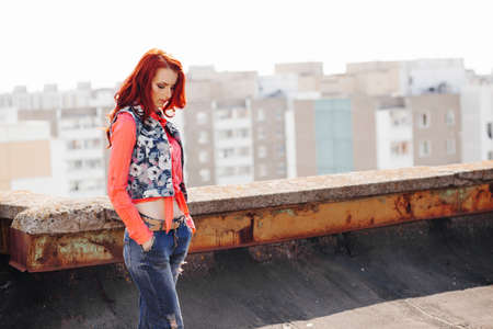 girl shirt: Beautiful redhair girl in casual on the rooftop Stock Photo