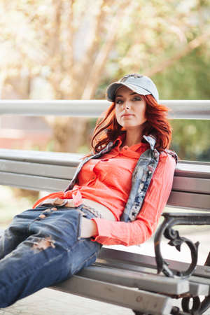 ringlets: Beautiful redhair girl in casual on the bench