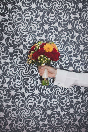 blackwhite: A bouquet of flowers in hand on the black-white background Stock Photo