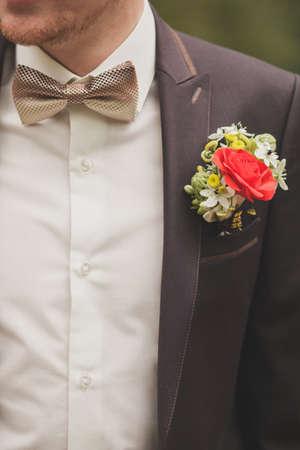 warm shirt: Grooms buttonhole flower