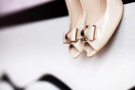 womans: A detail of beige womans shoes