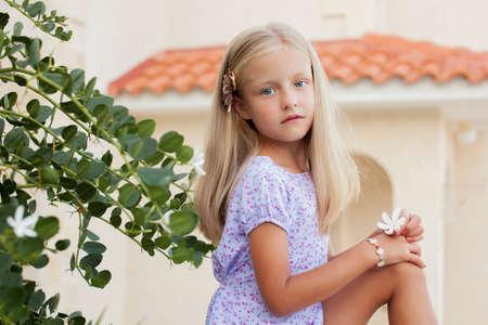 little girl barefoot: Portrait of a beautiful pretty girl in summer outdoor