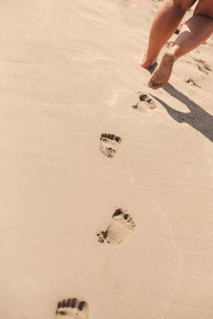 Footprints on the sand after the girl's walk