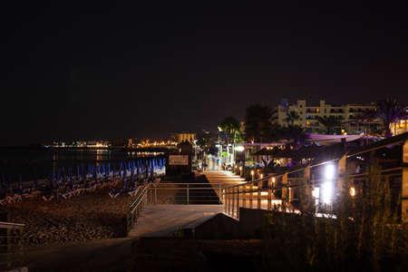 Beautiful seashore at night, pedestrian sidewalk on seashore Stock Photo